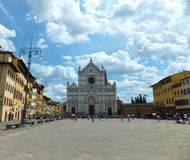 View of the facade of Basilica di Santa Croce in Florence, Italy as seen from under the high blue sky with brigh stock photos