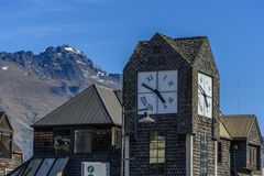 View of the facade of the building with a clock, Queenstown, New Zealand royalty free stock photography