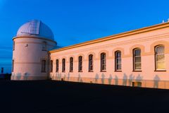 View of the facade of the main building of the historical Lick Observatory (completed in 1888) at sunset; visitors ' shadows. Projected on its walls; San Jose royalty free stock images