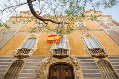 Valencia city in Spain. View on the facade of the national museum of ceramics and decorative arts building with spanish flag in Valencia city, Spain Royalty Free Stock Images