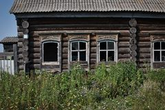View on the facade of an old village house. With broken windows stock photography