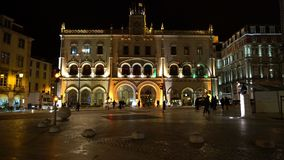 Rossio railway station in Lisbon. A view of the facade of Rossio railway station by night in Lisbon, Portugal stock footage