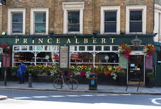 A view of the facade of the traditional English pub Prince Albert in Notting Hill, London, United Kingdom. LONDON, UK - August 11, 2017: A view of the facade of Royalty Free Stock Photography