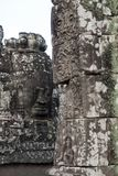 View of a face on the terrace at Bayon Wat, a 12th century temple within the Angkor Thom complex royalty free stock images