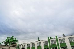 View of the factory.Green building on blue sky background royalty free stock photos