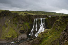 View of the Fagrifoss (Beautiful waterfall) on a cloudy evening, Royalty Free Stock Photography