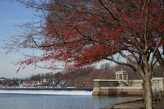 View of the Fairmont Water Works and boathouse row from the pedestrian walkway. Stock Images