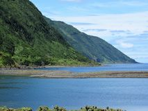 View from faja Santo Cristo, Sao Jorge, The Azores. View of the Sao Jorge coastline across a lagoon on faja Santo Cristo, The Azores stock images