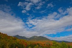 View with fall folliage from Mt. Washington, New Hampshire, USA. Fall foliage around Mt. Washington and the Presidential Range in New Hampshire, New England, USA stock images