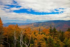 View with fall folliage from Mt. Washington, New Hampshire, USA. Fall foliage around Mt. Washington and the Presidential Range in New Hampshire, New England, USA stock photo