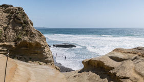 View of family playing on the beach from higher up Torrey Pines. Best trails at the Torrey Pines Natural Reserve royalty free stock photo