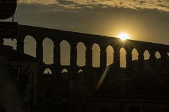 View of the famous Aqueduct of Segovia at Sunset. Roman construction of the 1st century. Travel concept. Spain, Castile and Leon, Segovia royalty free stock image