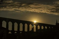 View of the famous Aqueduct of Segovia at Sunset. Roman construction of the 1st century. Travel concept. Spain, Castile and Leon, Segovia stock photos