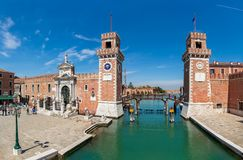 View of famous Arsenal in Venice, Italy. VENICE, ITALY - APRIL 21, 2016: View of small piazza and towers off famous Venetian Arsenal - complex of former stock photography