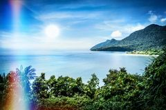 View of the famous Damai bay in south-west Borneo. Malaysia, with sun reflex and lightleak Royalty Free Stock Photo