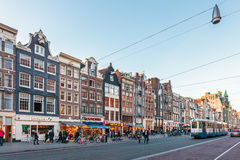 View at the famous Damrak during sunset in Amsterdam, The Nether Royalty Free Stock Photography