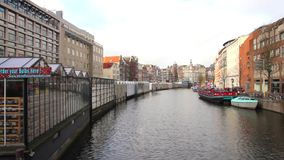 View of the famous flower market and canal, Amsterdam stock video footage