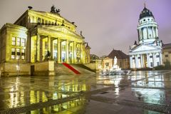 Gendarmenmarkt square illuminated during sunset in Berlin city center, Germany Royalty Free Stock Photography