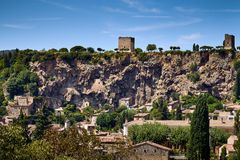 View of the famous historical Falaise of Cotignac and its towers stock images