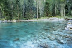 Italian Alps Lake. A view of famous lake in Val di Mello in the italian alps, details of water with beautiful turquoise long exposure that make a smooth effect stock photo