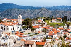 View of famous landmark tourist destination valley Pano Lefkara. Village, Larnaca, Cyprus. Ceramic tiled house roofs, greek orthodox church at south of Troodos royalty free stock photo