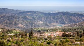 View of famous landmark tourist destination valley Pano Lefkara. Village, Larnaca, Cyprus. Ceramic tiled house roofs, greek orthodox church at south of Troodos royalty free stock image