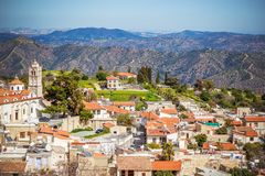 View of famous landmark tourist destination valley Pano Lefkara. Village, Larnaca, Cyprus. Ceramic tiled house roofs, greek orthodox church at south of Troodos royalty free stock images