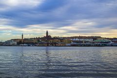View of the famous landmarks of Gothenburg, the Masthugget Church and the Seaman Tower. Gothenburg / Sweden - Dec 25 2018: View across the river Gota Alv stock photos