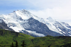 View at the famous mountain the Jungfrau in Swizerland. Beautiful mountain landscape with glaciers, view at the famous mountain the Jungfrau in Switzerland Royalty Free Stock Photo