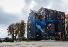 View of the famous mural of a giant blue wale on an abandoned old gray building in Zagreb, Croatia stock photography