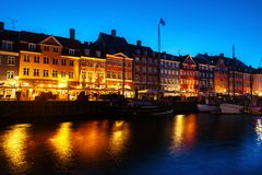 View of famous Nyhavn area in the center of Copenhagen, Denmark at night royalty free stock photography