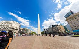 View on the famous Obelisco in Buenos Aires. BUENOS AIRES, ARGENTINA - CIRCA FEBRUARY 2019: View on People pass by in front of the famous Obelisk landmark in the stock photos