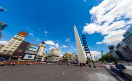 View on the famous Obelisco in Buenos Aires. BUENOS AIRES, ARGENTINA - CIRCA FEBRUARY 2019: View on People pass by in front of the famous Obelisk landmark in the royalty free stock images