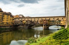 Famous Ponte Vecchio bridge in Florence, Italy. View on famous Ponte Vecchio bridge from the banks of the Arno river in Florence, Italy Royalty Free Stock Images
