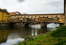 Famous Ponte Vecchio bridge in Florence, Italy. View on famous Ponte Vecchio bridge from the banks of the Arno river in Florence, Italy Stock Photography
