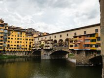 Famous Ponte Vecchio bridge in Florence, Italy. View on famous Ponte Vecchio bridge from the banks of the Arno river in Florence, Italy Stock Image