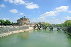 View on famous Saint Angel castle and bridge over the Tiber river in Rome, Italy Royalty Free Stock Image