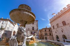 View of famous square with fountain Piazza del Comune in Assi stock images