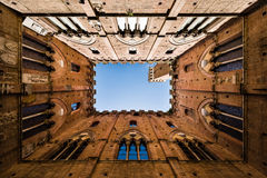 View of famous Torre del Mangia in Siena, Tuscany, Italy Royalty Free Stock Photos