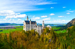View of the famous tourist attraction in the Bavarian Alps - the 19th century Neuschwanstein castle. Stock Photos