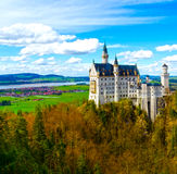 View of the famous tourist attraction in the Bavarian Alps - the 19th century Neuschwanstein castle. Royalty Free Stock Photography