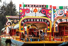 View of the famous trajineras of Xochimilco located in Mexico City. Boats at ancient aztec channels district of Xochimilco stock photo