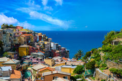 View of famous travel landmark destination Manarola colorful houses and nature, small mediterranean old sea town with Royalty Free Stock Photo