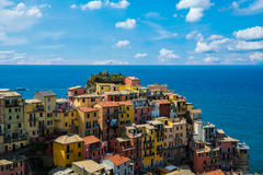 View of famous travel landmark destination Manarola colorful houses and nature, small mediterranean old sea town with Stock Photography
