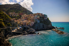 View of famous travel landmark destination Manarola, small mediterranean old sea town with harbour coast,Cinque terre Royalty Free Stock Images