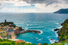 View of famous travel landmark destination Vernazza, a small mediterranean old sea town with harbour,coast and castle Stock Photo