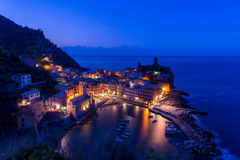 View of famous travel landmark destination Vernazza, small mediterranean old sea town with harbour coast and castle Royalty Free Stock Photo