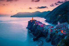 View of famous travel landmark destination Vernazza,small mediterranean old sea town with harbour coast and castle Stock Photo