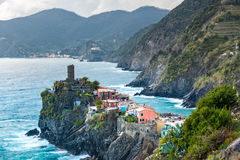View of famous travel landmark destination Vernazza, a small mediterranean old sea town with harbour coast and castle Royalty Free Stock Images