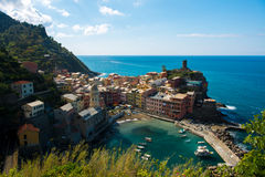 View of famous travel landmark destination Vernazza, small mediterranean old sea town with harbour coast and castle Stock Photo